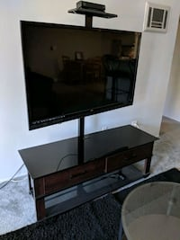 black flat screen TV with brown wooden TV stand La Mesa, 91942