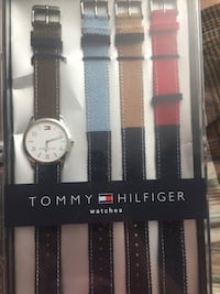 round black and silver Tommy Hilfiger analog watch