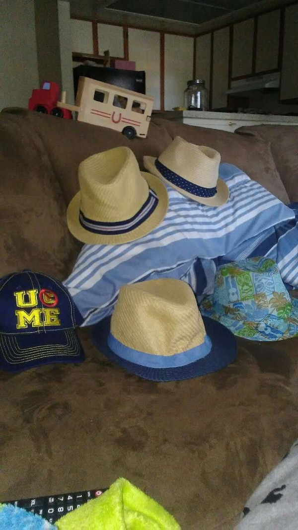 Used black and yellow UME embroidered cap and four fedora hats for sale in  Moreno Valley - letgo ca4d1c150de