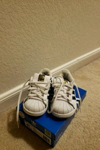 pair of white-and-blue Adidas sneakers 1213 mi