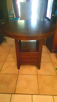 round brown wooden table with two chairs Pasadena
