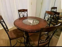round brown wooden table with four chairs dining s Lafayette