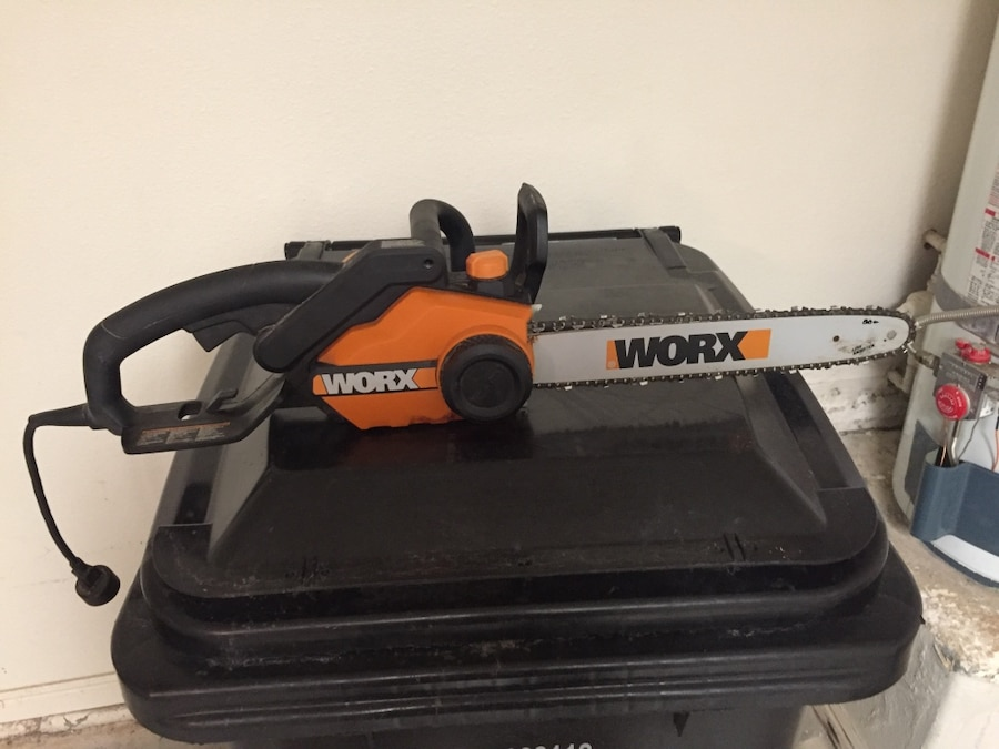 Orange and black Worx chainsaw