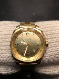 Round gold-colored nixon analog watch with link bracelet Shoreline, 98155