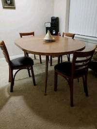 round brown wooden table with four chairs dining set Manassas, 20110