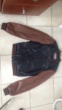 Black Leather and sleeves brown jacket serious buyers pls