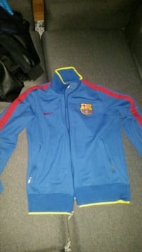 blue and red Nike zip-up jacket