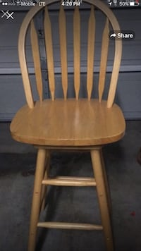 brown wooden windsor chair with brown cushion 2250 mi