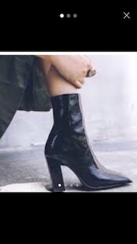 pair of black leather heeled boots London, E1 4PH