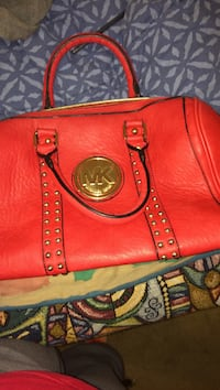 red leather Michael Kors tote bag