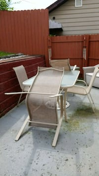 Deck glass table and 4 chairs. Cumberland, 21502
