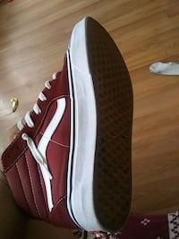 unpaired red and white Vans low top sneaker Baltimore, 21223