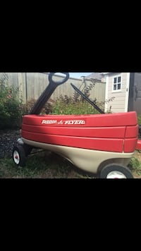 Red wagon for sale has a small compartment for storage Vaughan, L4H 3P6