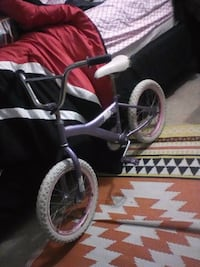 toddler's pink and white bicycle 228 mi