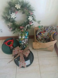 Christmas wreath, ornaments, bow, 2 tree stands and lights.
