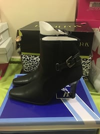 pair of black leather side zip boots