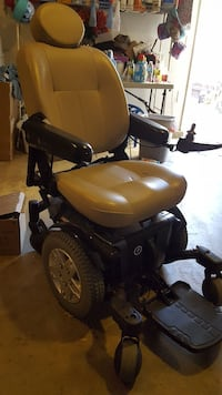 yellow and black motorized wheelchair