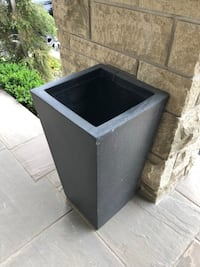 Planters resin brown in color 2 available as is. $40 each Vaughan, L4L