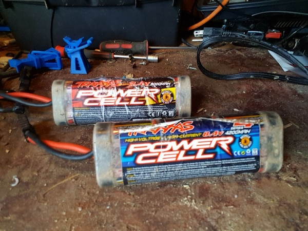 two black Power Cell car audio capacitors
