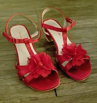 pair of red open-toe ankle strap sandals