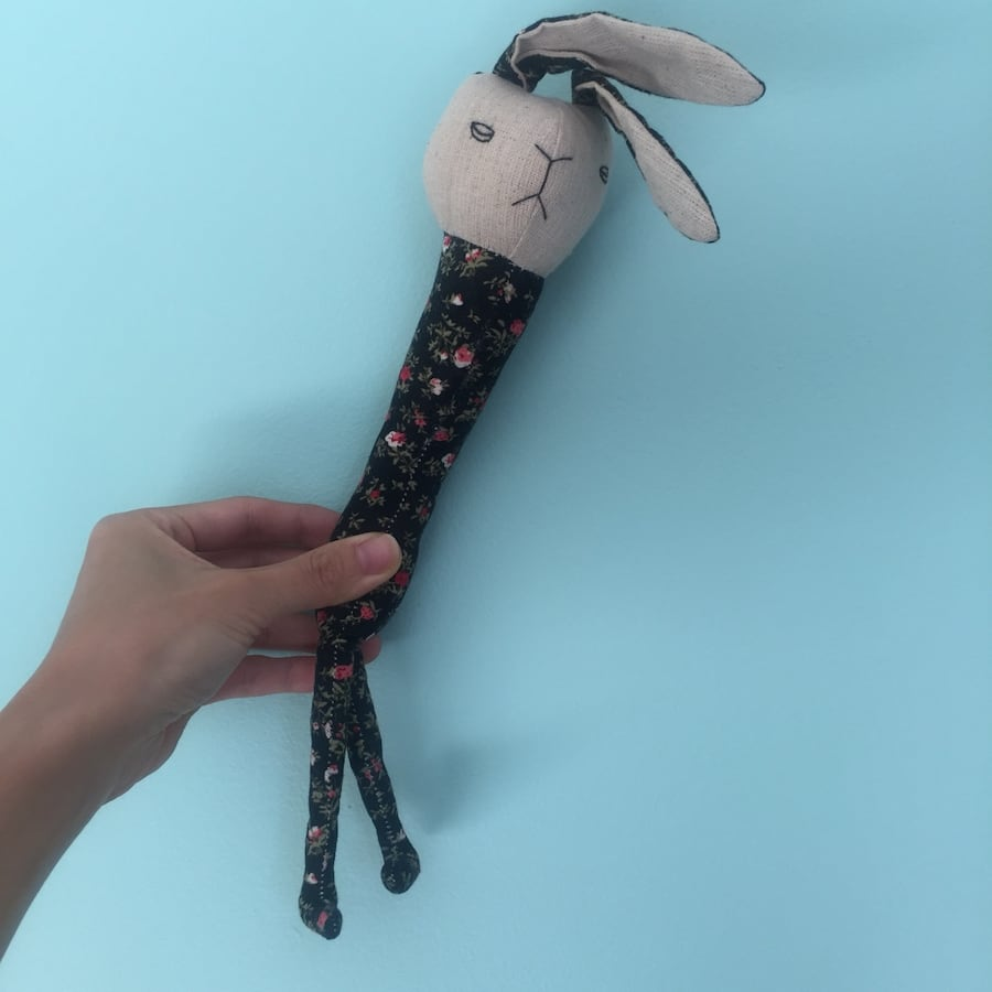 Black and gray bunny plush toy