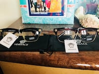 two black-and-brown frame Versace Clubmaster sunglasses