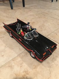 Bat mobile with Batman and Robin