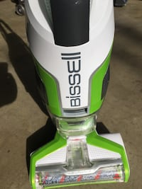 white and green Bissell upright vacuum cleaner Ontario, 91762