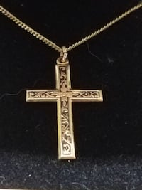 gold-colored cross chain necklace