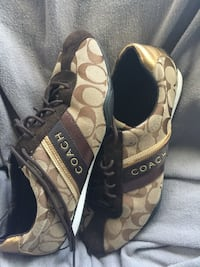 pair of brown-and-black Coach sandals Corona, 92882