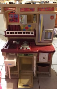 Toy kitchen & MORE- see Pics- with electronic stove top with pot, real working shopping cart, microwave, blender, food, utensils, apron, mitts and bakers hat