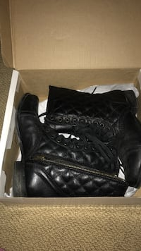 Steve Madden black leather boots  Dollard-des-Ormeaux, H9A