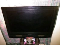 black flat screen TV with remote Fayetteville, 28311