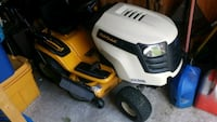 yellow and white Cub Cadet riding mower 71 km