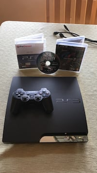 Black sony ps3 slim console with controller and game cases Oxnard, 93036