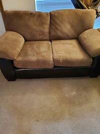 Brown and black microfiber and leather couch and loveseat
