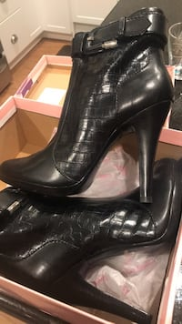 pair of black leather heeled shoes with box North Vancouver, V7N 3T5