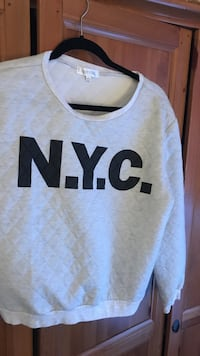white N.Y.C. quilted sweater