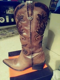 pair of brown leather cowboy boots 889 mi