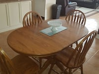 brown wooden 5-piece dining table