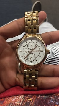 Gold plated fossil watch with diamond cuts custome made