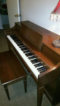 brown and white upright piano Pearland, 77584