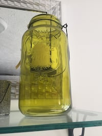 yellow and clear glass bottle