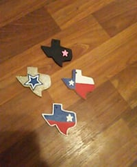 four Texas flag wooden boards