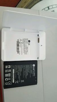 LG extra battery worth charger case.