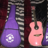 pink and black acoustic guitar with purple gig bag