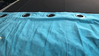 Long velvety turquoise curtains