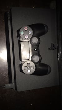 black Sony PS4 console with controller Halifax, B3R 1K2