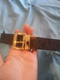 gold-colored Hermes buckle with brown leather belt Pflugerville, 78660