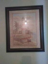 brown wooden framed painting of house 955 mi